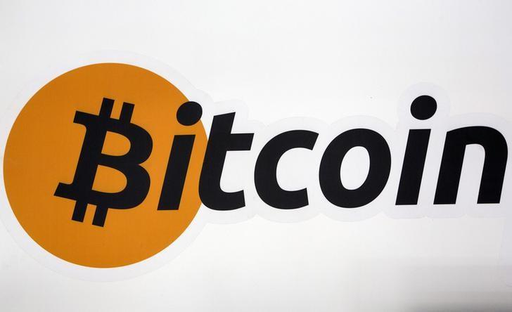 A Bitcoin logo is displayed at the Bitcoin Center New York City in New York's financial district, U.S. on July 28, 2015. REUTERS/Brendan McDermid/Files