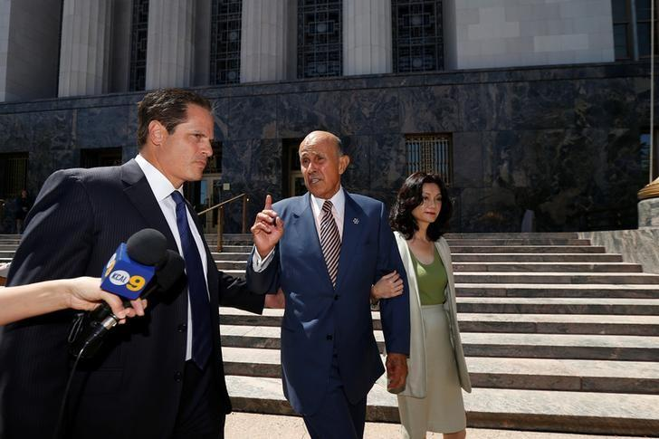 Former Los Angeles County Sheriff Lee Baca (C), accompanied by his wife Carol Chiang and attorney David Hochman, leaves Federal court after being arraigned on charges of conspiring to obstruct justice, obstructing justice and lying to the federal government in Los Angeles, California U.S., August 12, 2016.   REUTERS/Mario Anzuoni
