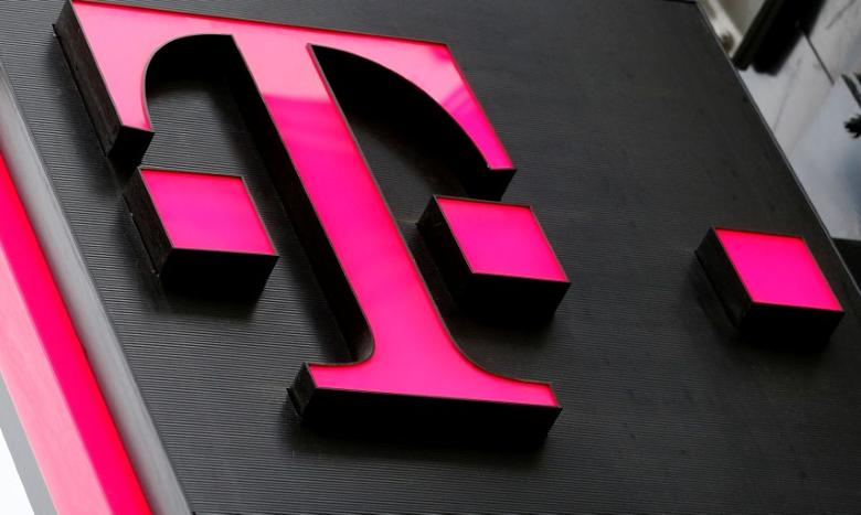 The logo of T-Mobile Austria is seen outside of one of its shops in Vienna, Austria, February 25, 2016.   REUTERS/Leonhard Foeger/File Photo