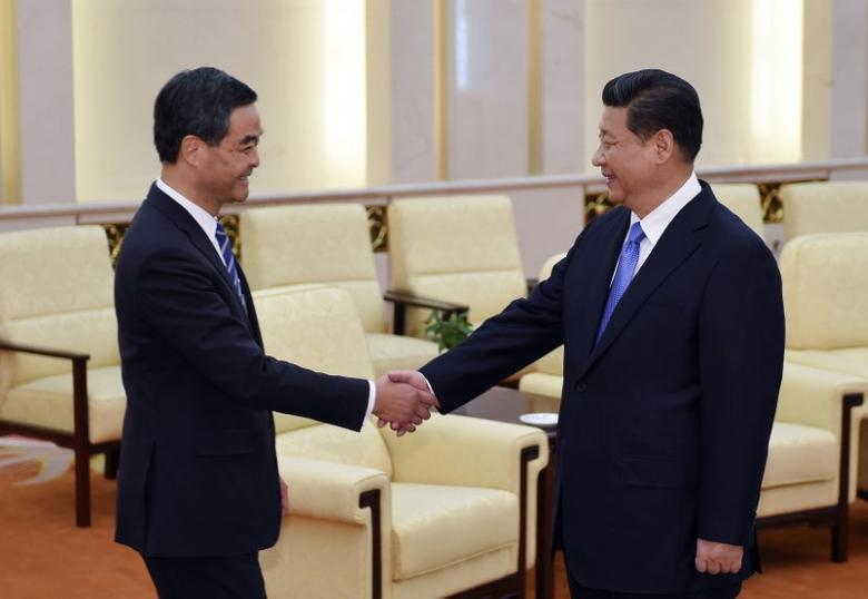 China's President Xi Jinping (R) shakes hands with Hong Kong Chief Executive Leung Chun-ying during a meeting at the Great Hall of the People in Beijing, November 9, 2014.  REUTERS/Stringer
