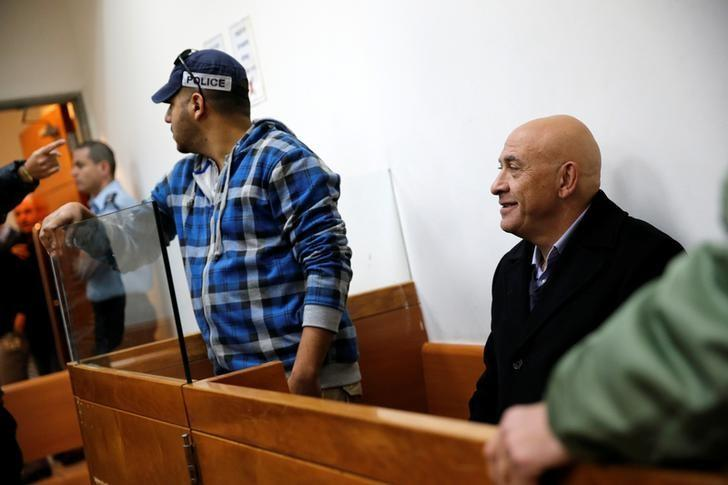 Israeli Knesset member Basel Ghattas sits at the Magistrates Court as police suspect Ghattas of smuggling mobile telephones into an Israeli jail for Palestinian convicts imprisoned for security offences against the state, in Rishon Lezion, Israel December 23, 2016. REUTERS/Amir Cohen
