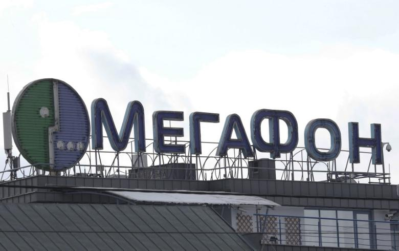 An advertising board with logo of Russian mobile phone operator MegaFon is installed on the roof of a building in Moscow, Russia, February 27, 2016. REUTERS/Grigory Dukor