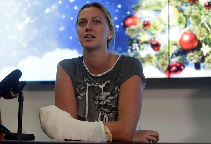 Czech Republic's tennis player Petra Kvitova speaks during a news conference, after she was injured on Tuesday when she fought off an intruder in her home, damaging all the fingers on her playing hand, in Prague, Czech Republic December 23, 2016.    REUTERS/David W Cerny