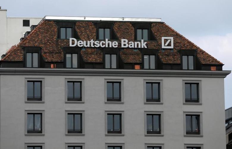 A logo is pictured on the Deutsche Bank building in Geneva, Switzerland, October 11, 2016.  REUTERS/Denis Balibouse