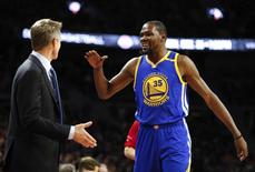 Dec 23, 2016; Auburn Hills, MI, USA; Golden State Warriors forward Kevin Durant (35) gives five to head coach Steve Kerr during the first quarter against the Detroit Pistons at The Palace of Auburn Hills. Mandatory Credit: Raj Mehta-USA TODAY Sports