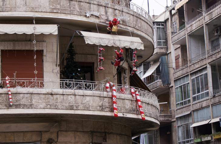 Christmas ornaments decorate a balcony in Aleppo, Syria December 12, 2009. Picture taken December 12, 2009. REUTERS/Khalil Ashawi/Files