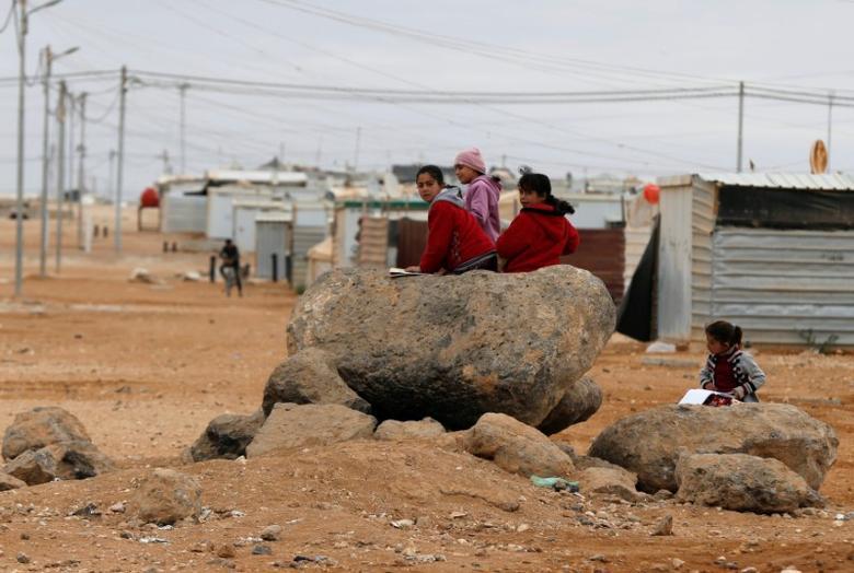 Syrian refugee children play at Al Zaatari refugee camp in Jordan, near the border with Syria, November 30, 2016. REUTERS/Muhammad Hamed