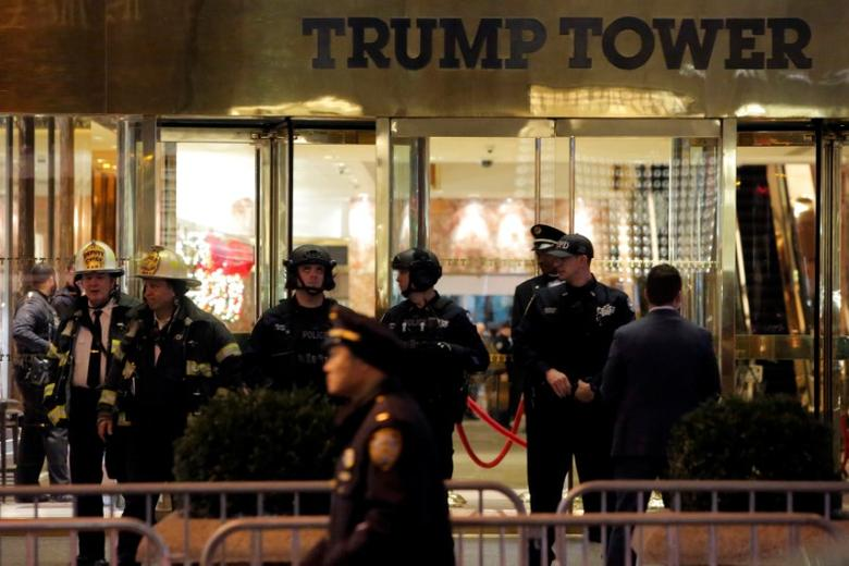 Police and fire crew stand outside Trump Tower following a report of a suspicious package in Manhattan, New York City, U.S., December 27, 2016.  REUTERS/Andrew Kelly