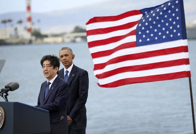 Japanese Prime Minister Shinzo Abe (L) delivers remarks as U.S. President Barack Obama looks on at Joint Base Pearl Harbor-Hickam, Hawaii, U.S., December 27, 2016. REUTERS/Kevin Lamarque
