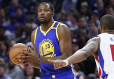 Dec 23, 2016; Auburn Hills, MI, USA; Golden State Warriors forward Kevin Durant (35) gets defended by Detroit Pistons forward Marcus Morris (13) during the first quarter at The Palace of Auburn Hills. Mandatory Credit: Raj Mehta-USA TODAY Sports