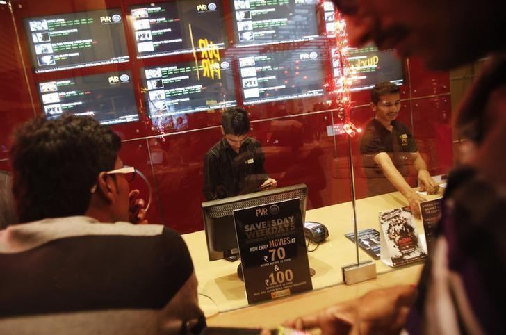 Cinema-goers wait to collect their tickets at a PVR Multiplex in Mumbai November 10, 2013. REUTERS/Danish Siddiqui/Files