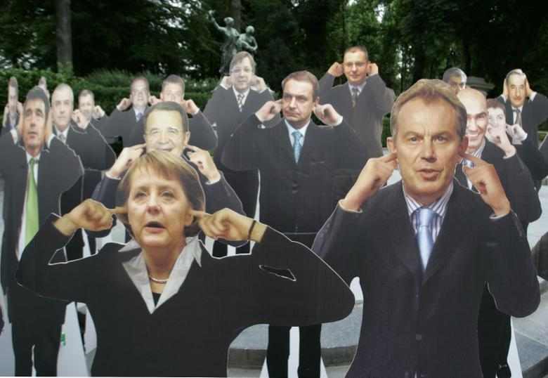Life-size placards of German Chancellor Angela Merkel (L) and former British Prime Minister Tony Blair (R) are displayed among placards of other EU leaders with fingers in their ears before the EU heads of state summit in Brussels June 21, 2007. REUTERS/Thierry Roge