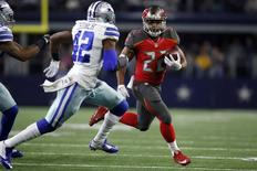 Dec 18, 2016; Arlington, TX, USA;  Tampa Bay Buccaneers running back Doug Martin (22) runs the ball against Dallas Cowboys strong safety Barry Church (42) in the first quarter at AT&T Stadium.  Tim Heitman-USA TODAY Sports