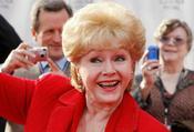 Factbox: 'เธอเสียชีวิตด้วยหัวใจที่แตกสลาย' - ความเห็นต่อการตายของ Debbie Reynolds