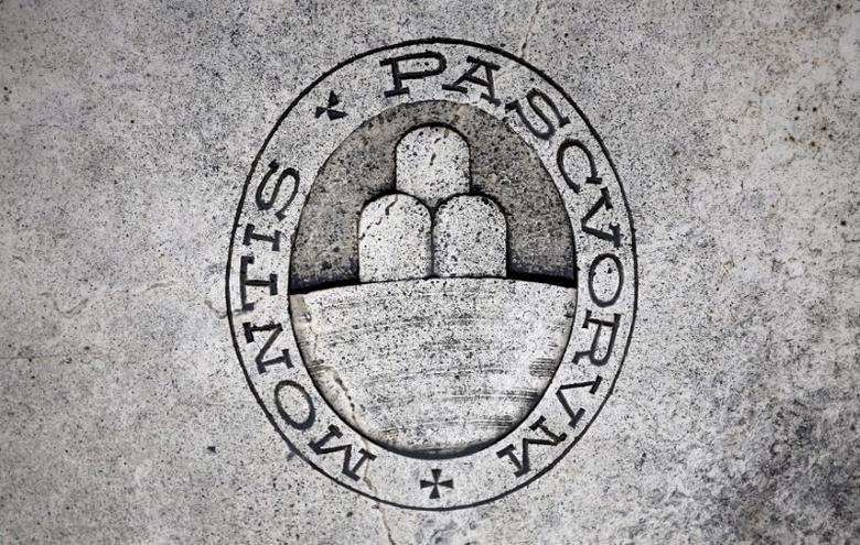 A logo of Monte dei Paschi di Siena bank is seen on the ground in Siena, Italy, November 5, 2014. REUTERS/Giampiero Sposito/File Photo - RTX2VB64