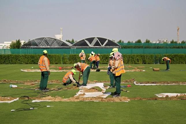 Workers test soil as they grow grass for Qatar's 2022 World Cup, at an experimental facility in Doha, Qatar November 29, 2016. REUTERS/Naseem Zeitoon/Files