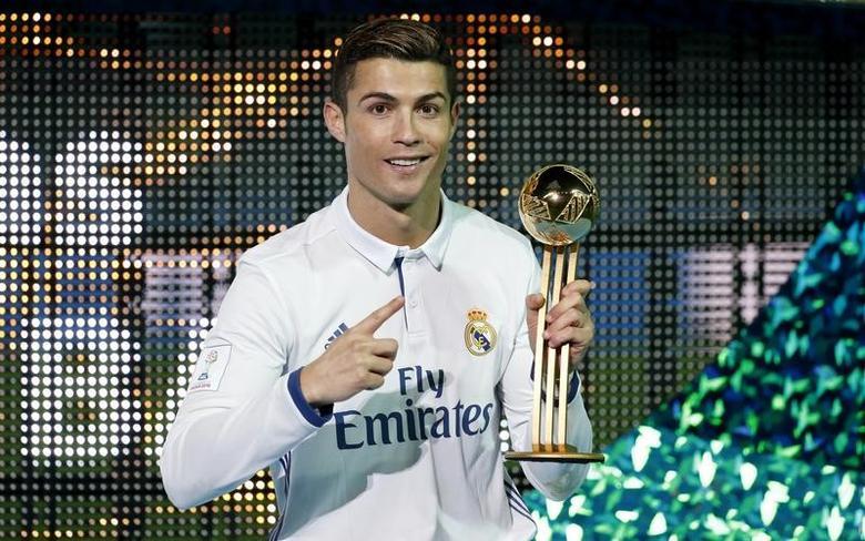 Football Soccer - Real Madrid v Kashima Antlers - FIFA Club World Cup Final - International Stadium Yokohama - Japan , 18/12/16 Real Madrid's Cristiano Ronaldo celebrates with the Golden Ball trophy Reuters / Kim Kyung-Hoon Livepic