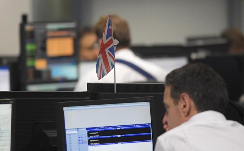 Traders at BGC Partners look at screens in London in this file photo. REUTERS/Toby Melville