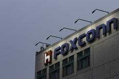 The logo of Foxconn, the trading name of Hon Hai Precision Industry, is seen on top of the company's headquarters in New Taipei City, Taiwan March 29, 2016. REUTERS/Tyrone Siu/File Photo