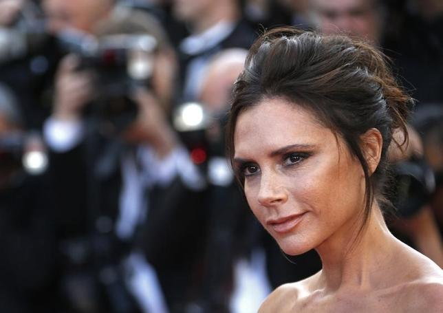 Fashion designer, model and singer Victoria Beckham poses on the red carpet as she arrives for the opening ceremony and the screening of the film ''Cafe Society'' out of competition during the 69th Cannes Film Festival in Cannes, France, May 11, 2016.   REUTERS/Yves Herman