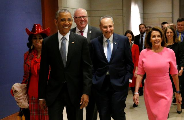 U.S. President Barack Obama arrives with Rep. Frederica Wilson (D-FL), New York Rep. Joe Crowley (D-NY), Senate Democratic Leader Chuck Schumer and House Democratic Leader Nancy Pelosi to meet with House and Senate Democrats to discuss a strategy on congressional Republicans' effort to repeal the Affordable Care Act in the U.S. Capitol in Washington January 4, 2017. REUTERS/Kevin Lamarque