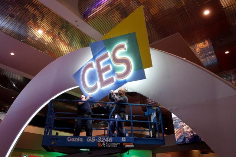 Workers hang signage in the lobby of the Las Vegas Convention Center as they prepare for the 2017 International CES technology trade show in Las Vegas, Nevada January 3, 2017. REUTERS/Steve Marcus