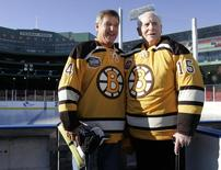 Former Boston Bruins greats Bobby Orr (L) and Milt Schmidt participate in the 'First Skate at Fenway Park'  in Boston, Massachusetts December 18, 2009, in advance of the NHL's Winter Classic game between the Boston Bruins and the Philadelphia Flyers to be played January 1, 2010.    REUTERS/Adam Hunger
