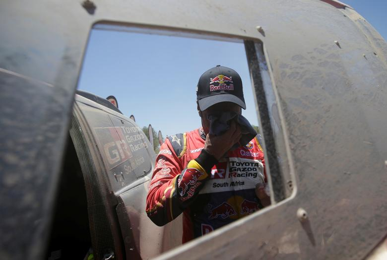 Dakar Rally - 2017 Paraguay-Bolivia-Argentina Dakar rally - 39th Dakar Edition - Second stage from Resistencia to San Miguel de Tucuman, Argentina 03/01/17. Nasser Al-Attiyah of Qatar cleans his face after driving his Toyota with his co-pilot Matthieu Baumel.  REUTERS/Ricardo Moraes