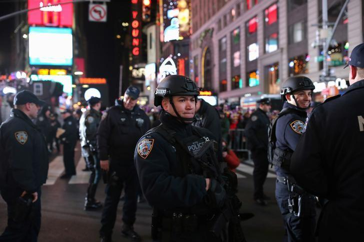 NYPD ESU officers in Times Square in preparation for the New Year's celebration in Manhattan, New York City, U.S., December 31, 2016. REUTERS/Stephen Yang