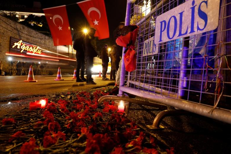 Flowers are placed in front of a police barrier near the entrance of Reina nightclub by the Bosphorus, which was attacked by a gunman, in Istanbul, Turkey, January 1, 2017. REUTERS/Umit Bektas