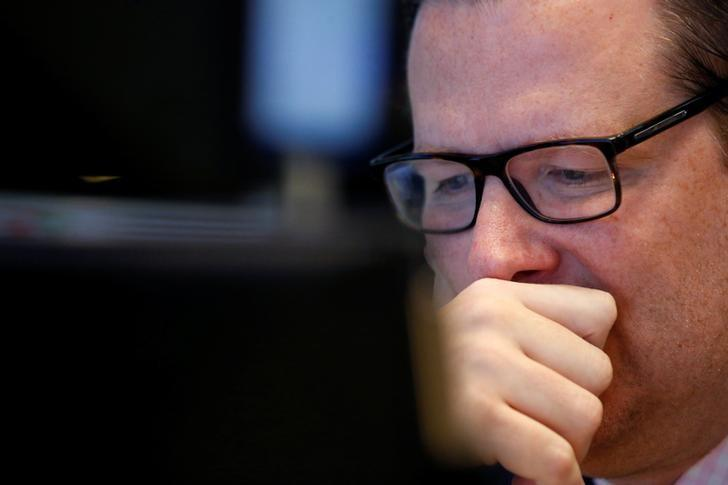 A specialist trader works at his post on the floor of the New York Stock Exchange (NYSE) in New York City, U.S., October 21, 2016.  REUTERS/Brendan McDermid/Files