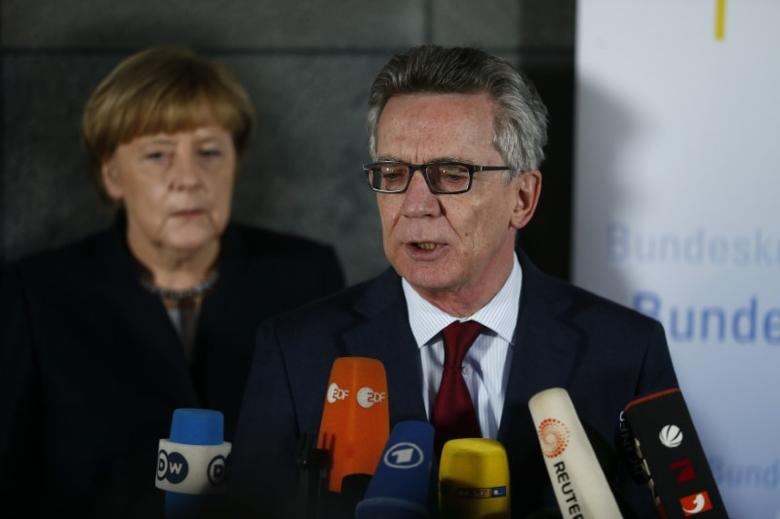 German Chancellor Angela Merkel (L) and Interior Minister Thomas de Maiziere during a statement after visiting the Bundeskriminalamt (BKA) Federal Crime Office Police in Berlin, Germany, December 22, 2016, following an attack by a truck which ploughed through a crowd at the market on Monday night. REUTERS/Hannibal Hanschke