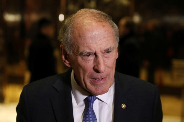 Senator Dan Coats (R-IN) stops to speak to the news media after a meeting at Trump Tower with U.S. President-elect Donald Trump in New York, U.S., November 30, 2016.  REUTERS/Lucas Jackson