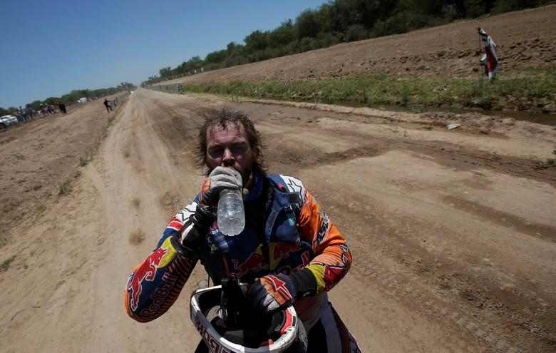 Dakar Rally - 2017 Paraguay-Bolivia-Argentina Dakar rally - 39th Dakar Edition - Second stage from Resistencia to San Miguel de Tucuman, Argentina 03/01/17. Toby Price of Australia drinks water at the arrival after riding his KTM. REUTERS/Ricardo Moraes