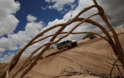 Dakar Rally - 2017 Paraguay-Bolivia-Argentina Dakar rally - 39th Dakar Edition - Fifth stage from Tupiza to Oruro, Bolivia 06/01/17. Juan Silva of Argentina drives his Mercedes with his copilot Sergio Lafuente. REUTERS/Ricardo Moraes