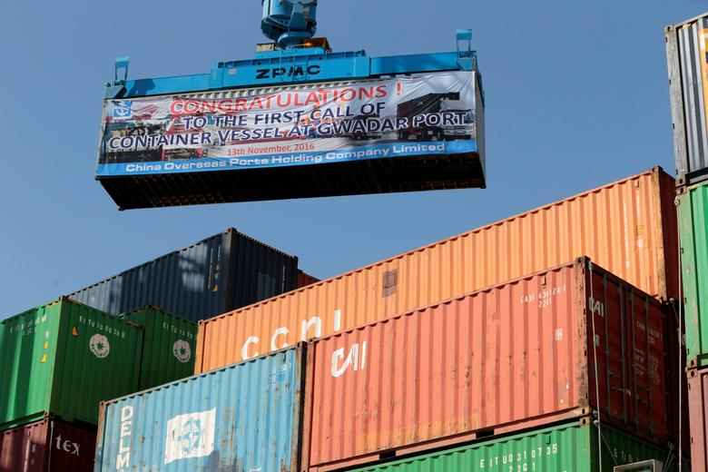 FILE PHOTO: A container is loaded on to the first Chinese container ship to depart after the inauguration of the China Pakistan Economic Corridor port in Gwadar, Pakistan November 13, 2016.  REUTERS/Caren Firouz/File Photo