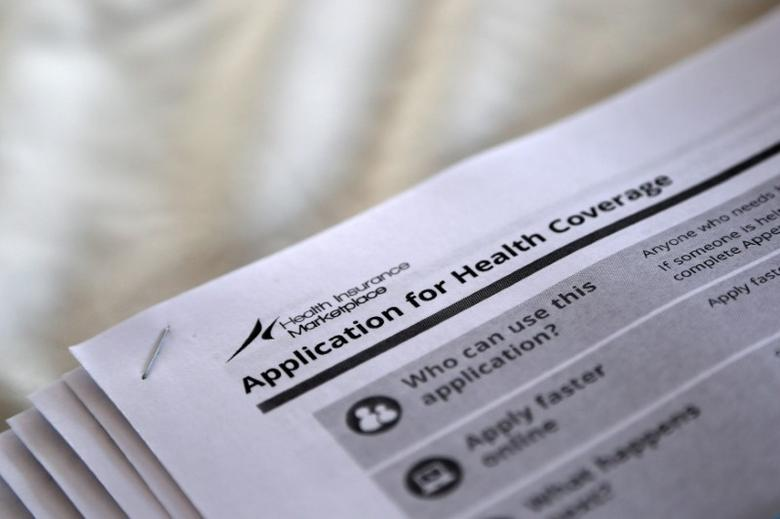 FILE PHOTO - The federal government forms for applying for health coverage are seen at a rally held by supporters of the Affordable Care Act, widely referred to as ''Obamacare'', outside the Jackson-Hinds Comprehensive Health Center in Jackson, Mississippi, U.S. on October 4, 2013.  REUTERS/Jonathan Bachman/File Photo - RTX2XKYF