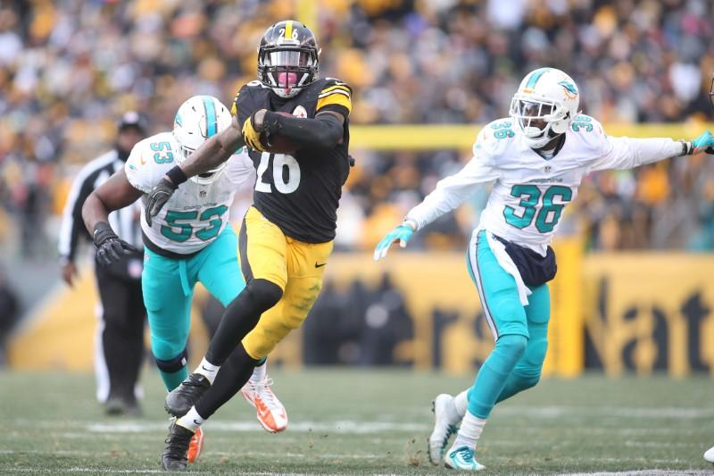 Steelers rout dolphins 30 12 advance to meet kansas city jan 8 2017 pittsburgh pa usa pittsburgh steelers running back leveon bell 26 carries the ball past miami dolphins cornerback tony lippett 36 and m4hsunfo