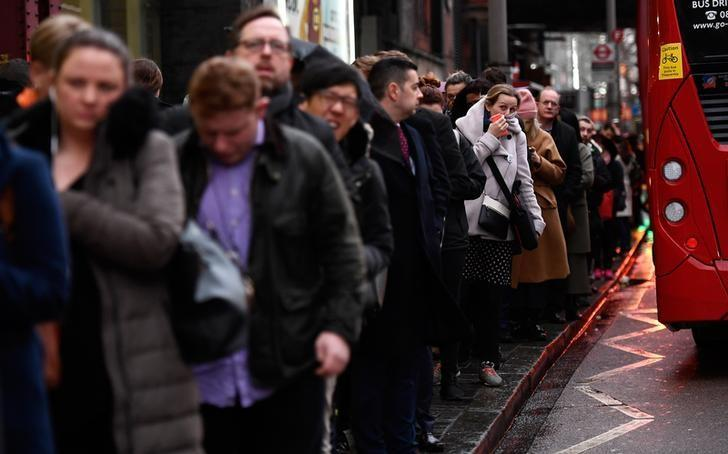 Travellers queue for buses outside the closed entrance to the Underground station at Waterloo during a strike by members of two unions in protest at ticket office closures and reduced staffing levels, in London, Britain January 9, 2017. REUTERS/Dylan Martinez