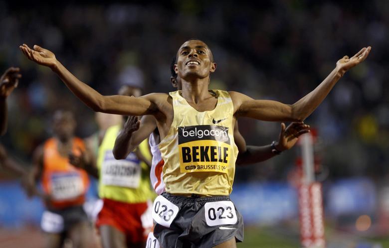 FILE PHOTO -  Kenenisa Bekele of Ethiopia crosses the finish line to win the men's 5000m race at the IAAF Golden League Memorial Van Damme athletics meeting in Brussels September 4, 2009      REUTERS/Francois Lenoir/File Photo