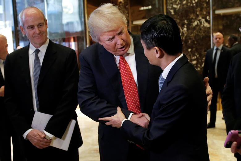 U.S. President-elect Donald Trump shakes hands with and Alibaba Executive Chairman Jack Ma after their meeting at Trump Tower in New York, U.S., January 9, 2017.   REUTERS/Mike Segar