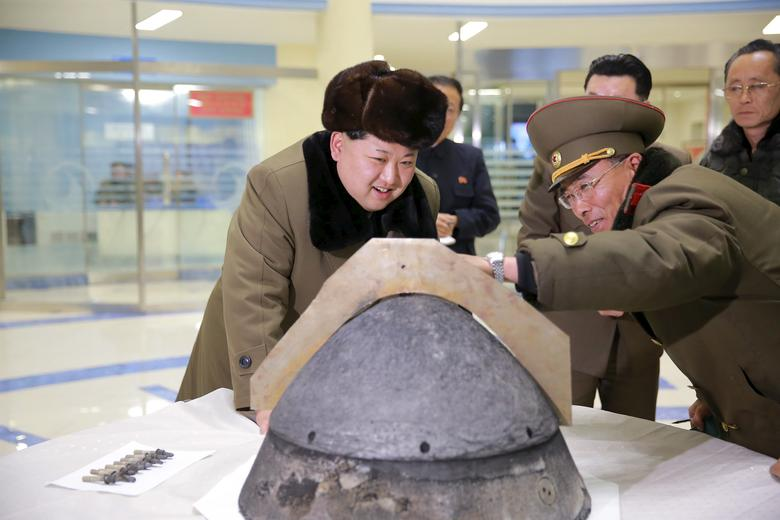 North Korean leader Kim Jong Un looks at a rocket warhead tip after a simulated test of atmospheric re-entry of a ballistic missile, at an unidentified location in this undated photo released by North Korea's Korean Central News Agency (KCNA) in Pyongyang on March 15, 2016.     REUTERS/KCNA/Files