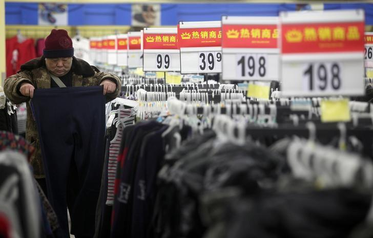 A customer selects trousers at a supermarket in Wuhan, Hubei province February 9, 2012. REUTERS/Stringer/Files