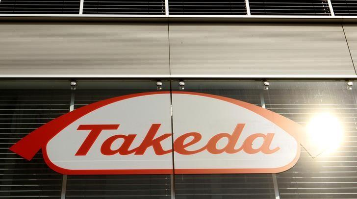 The logo of Japanese Takeda Pharmaceutical Co is seen at an office building in Glattbrugg near Zurich March 7, 2012.   REUTERS/Arnd Wiegmann/Files