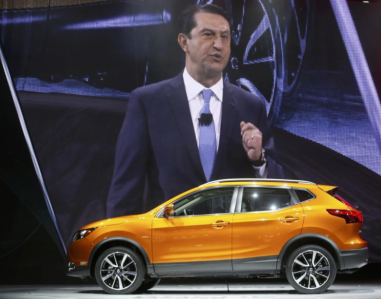 Jose Munoz, Chairman of Nissan North America, is shown on a large screen as he speaks about the 2017 Nissan Rogue Sport (foreground) during the North American International Auto Show in Detroit, Michigan, U.S., January 9, 2017.  REUTERS/Rebecca Cook