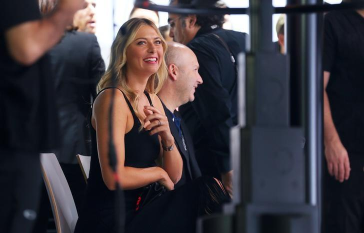 Tennis star Maria Sharapova looks on as Porsche introduces the new 2017 Porsche Panamera executive hybrid at the 2016 Los Angeles Auto Show in Los Angeles, California, U.S November 16, 2016.  REUTERS/Mike Blake/Files