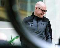 Team Sky chief Dave Brailsford smiles before a training session in Alcudia, on the island of Mallorca, Spain January 10, 2017. REUTERS/Enrique Calvo
