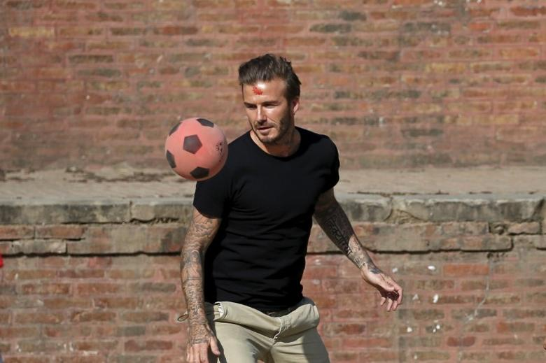 David Beckham plays soccer during the charity match to collect funds for the United Nations Children's Fund (UNICEF) at the ancient city of Bhaktapur, Nepal November 6, 2015. REUTERS/Navesh Chitrakar