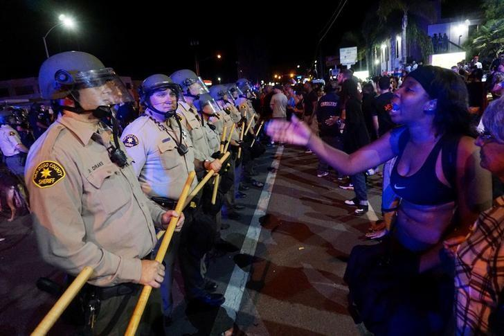 Protesters gather along Broadway Avenue to protest the fatal shooting of an unarmed black man by officers in El Cajon, California, U.S. September 28, 2016.  REUTERS/Sandy Huffaker/Files