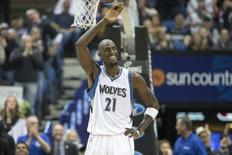 Feb 25, 2015; Minneapolis, MN, USA; Minnesota Timberwolves forward Kevin Garnett (21) smiles and waves to fans in the second half against the Washington Wizards at Target Center. Mandatory Credit: Jesse Johnson-USA TODAY Sports